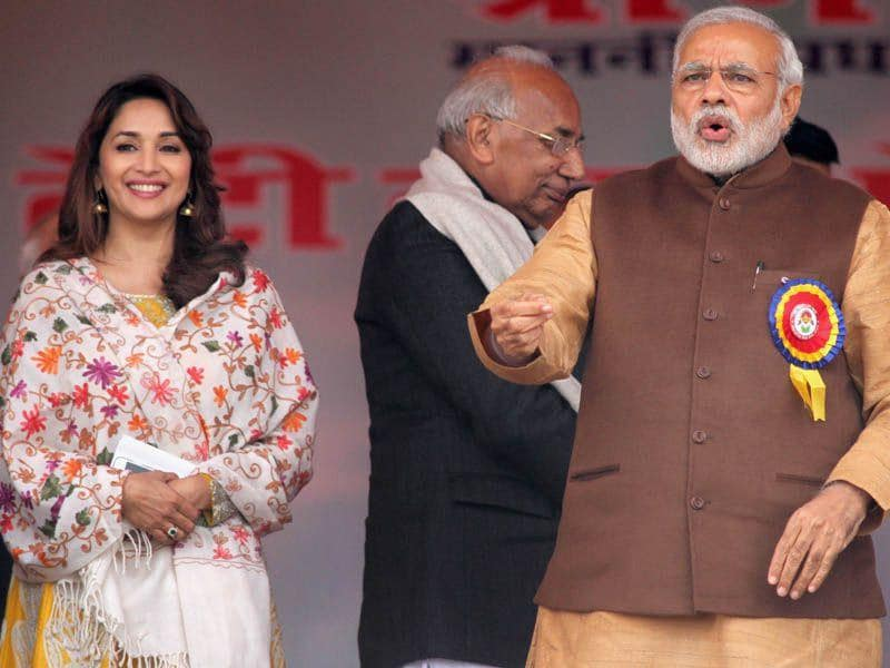 PM Narendra modi along with actor Madhuri Dixit during the launch of 'Beti Bachao Beti Padhao' rally at Panipat in Haryana on Thursday. Ravi Kumar/HT