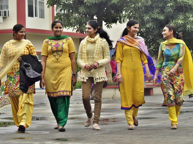Students wearing yellow on the eve of 'Basant Panchami' at Guru Nanak khalsa College for Women in Ludhiana on Thursday. Sikander Singh Chopra/HT