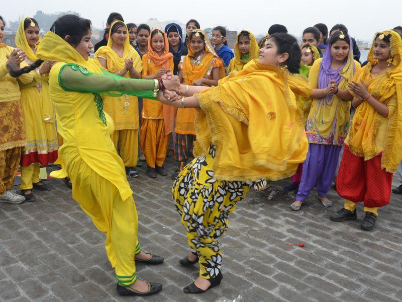 Students of Jagat Jyoti School in Amritsar dancing during Basant Panchami celebrations at their school on Friday . Sameer Sehgal/HT