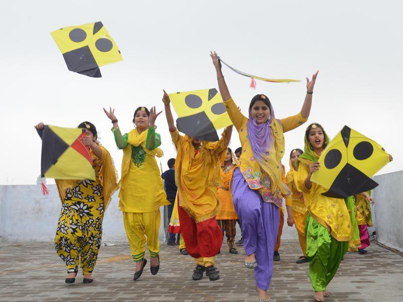 Excited students celebrating Basant Panchmi at their school in Amritsar on Friday. Sameer Sehgal/HT
