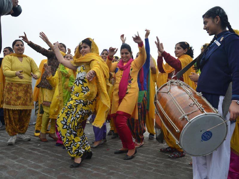 Students dancing to the beats of a dhol during Basant Panchami celebrations at their school in Amritsar. Sameer Sehgal/HT