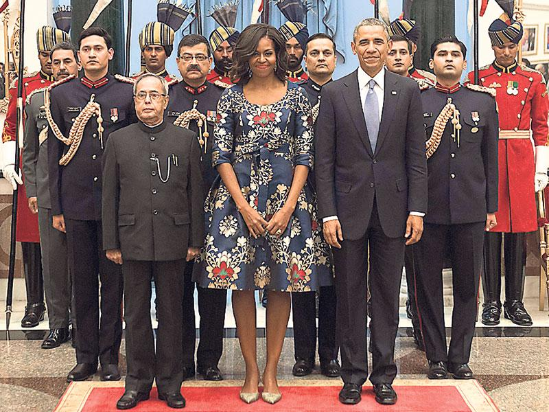 President Barack Obama, First Lady Michelle Obama and President Pranab Mukherjee stand during the US National Anthem before a receiving line at the State Dinner at the Rashtrapati Bhawan in New Delhi. (AP photo)