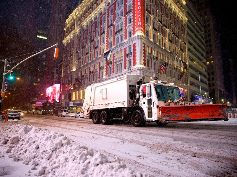 A plow is driven in Times Square following road closures in New York City. (AFP Photo)