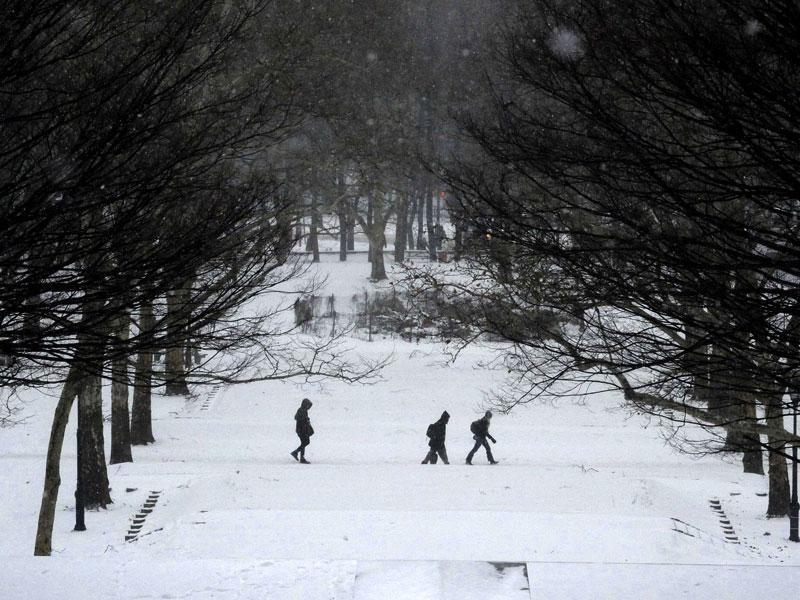 People walk in falling snow in Fort Greene Park in the Brooklyn borough in New York City. (Reuters Photo)