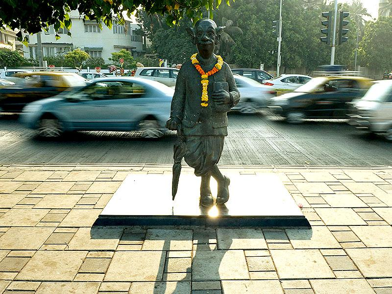 The statue of the 'common man', depicting cartoonist RK Laxman's satirical take on life, is seen on a pavement in Mumbai. Laxman died on January 26, aged 94. (AFP Photo)