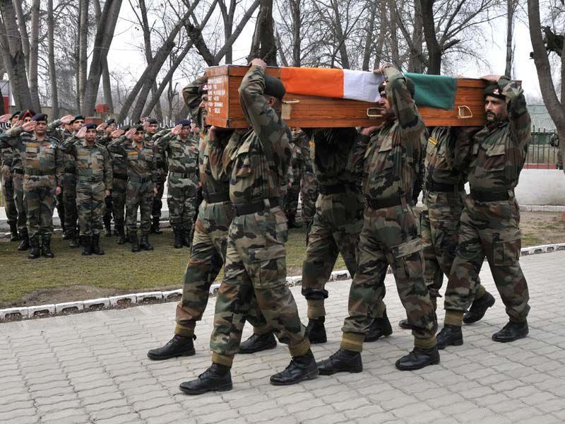 Army soldiers carry the coffin of Colonel Munindra Nath Rai during a wreath laying ceremony to pay homage at a military garrison in Srinagar on Wednesday. Waseem Andrabi/HT