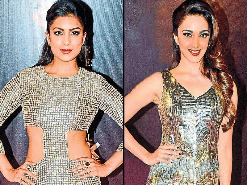 Giving the cut-out dress a chic spin, actor Pallavi Sharda walked the red carpet in a metallic-hued one, styled with statement ring and simple half-updo hairstyle | Mixing metallic hues, actor Kiara Advani was spotted in an ­embellished dress. Sparkly wedges and a pop of tangerine on the lips finished her look.