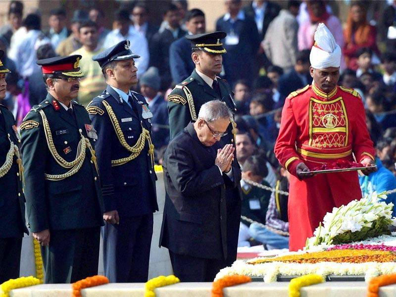 President Pranab Mukherjee pays tribute to Mahatma Gandhi on his death anniversary at Rajghat in New Delhi. (PTI Photo)
