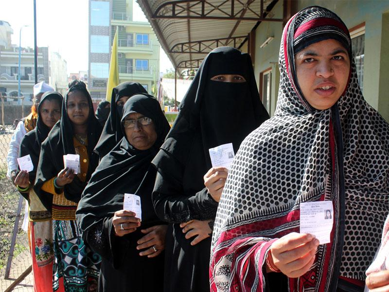 Muslim women stand in queue to cast their votes during municipal polls in Indore on Saturday. (Shankar Mourya/HT photo)