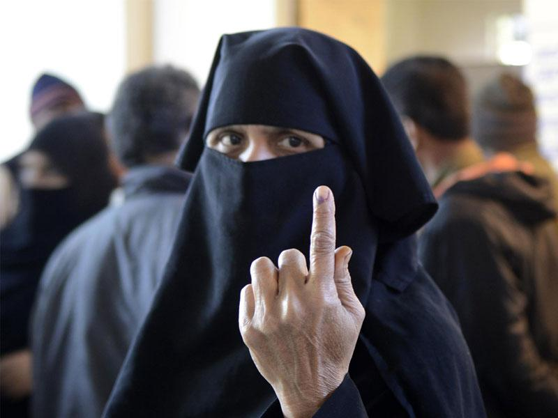 A woman shows her index finger after casting her vote during municipal polls in Bhopal. (Mujeeb Faruqui/HT file photo)