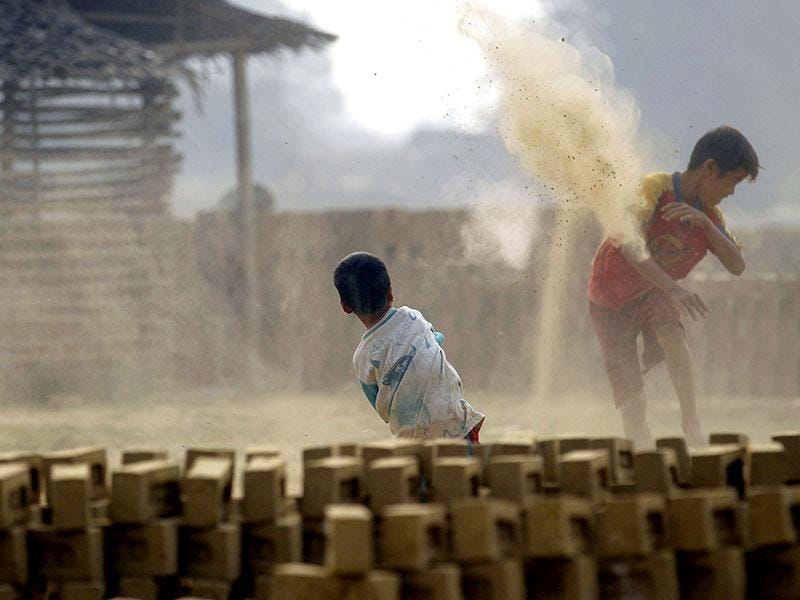 Boys play at a brick kiln on the outskirts of Yangon. (Reuters)
