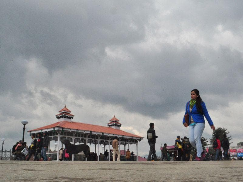 A girl walking under an overcast sky at The Ridge in Shimla. Santosh Rawat/HT