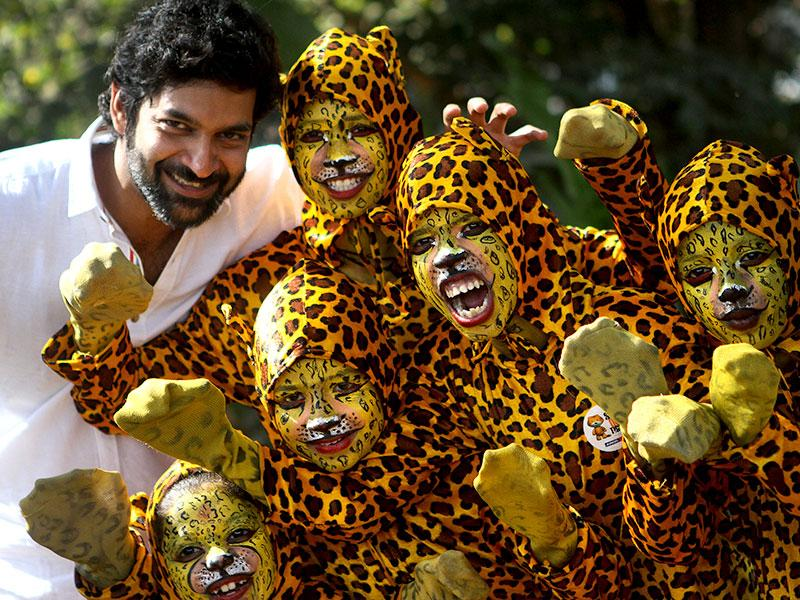Actor Purab Kohli poses with kids dressed as tigers during the 'Kids for Tiger' festival, a commitment to tiger conservation, at Maharashtra Nature Park in Mumbai. (Arijit Sen/HT photo)