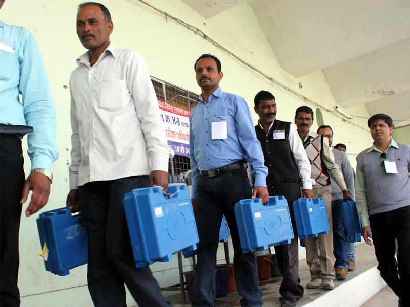 Ballot boxes being taken from the strong room to the counting hall in Indore on Wednesday. (Shankar Mourya/HT photo)