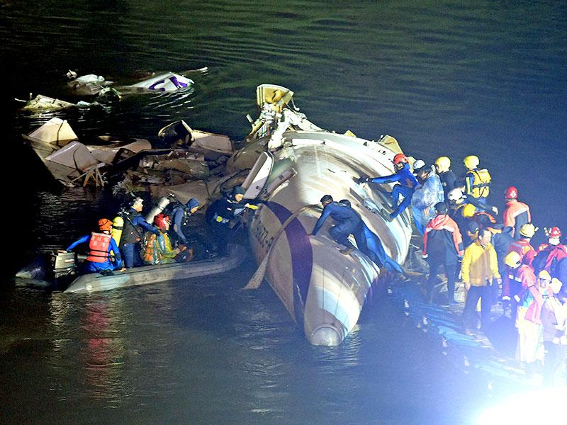 At least 26 passengers of the 58 people aboard were killed in the crash. (AFP Photo)