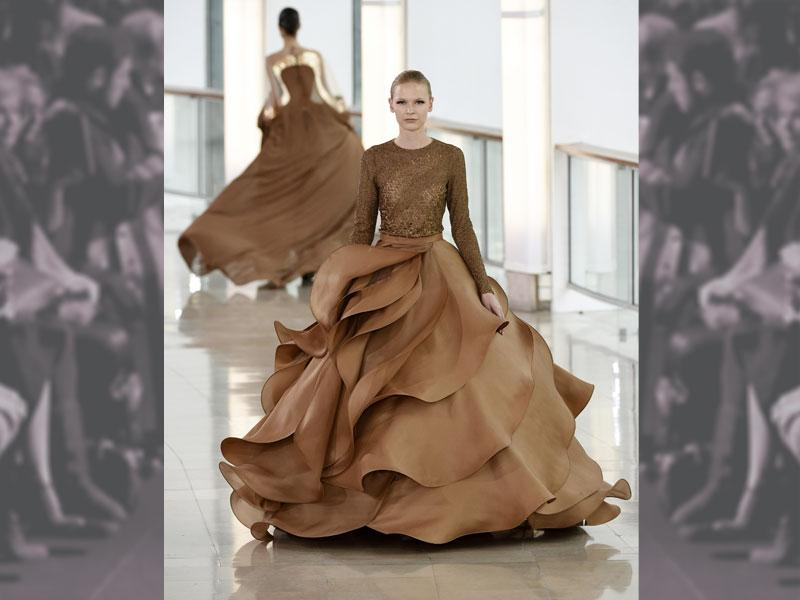 Graceful undulating ruffles, swirling rose petals at Stéphane Rolland