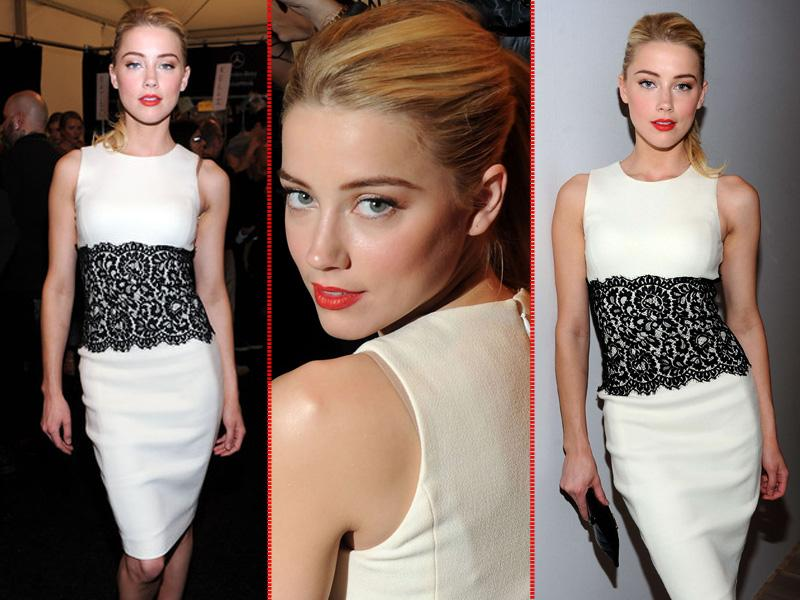 Amber Heard poses at a Michael Kors show in 2012. She appeared on the 2010 FHM Sexiest Women list at number 25