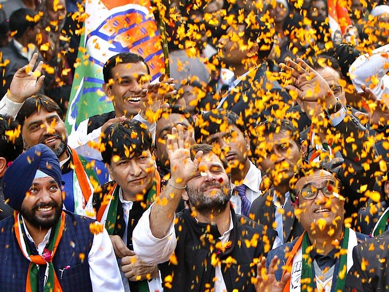 Congress supporters shower flower petals on party vice-president Rahul Gandhi during an election for Delhi assembly elections in New Delhi. (Arun Sharma/HT Photo)