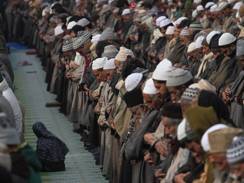 Kashmiri Muslims pray at the shrine of noted Muslim preacher and saint, Sheikh Syed Abdul Qadir Jeelani on Friday. Waseem Andrabi/HT