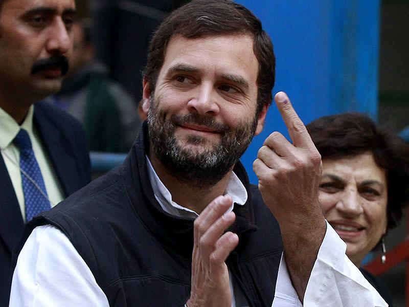Congress vice-president Rahul Gandhi shows his ink-marked finger after casting his vote at a polling station during the Delhi assembly elections. (HT Photo/Sanjeev Verma)