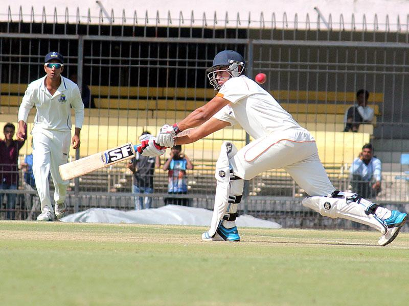 Mohnish Mishra of Madhya Pradesh in action against Bengal on the second day of Ranji match in Indore on Saturday. (Shankar Mourya/HT photo)