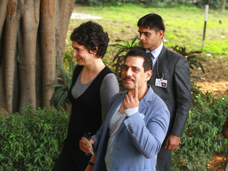 Priyanka Gandhi Vadra and her husband Robert Vadra after casting their vote at a polling station during the Assembly Elections in New Delhi. (Sanjeev Verma/HT Photo)