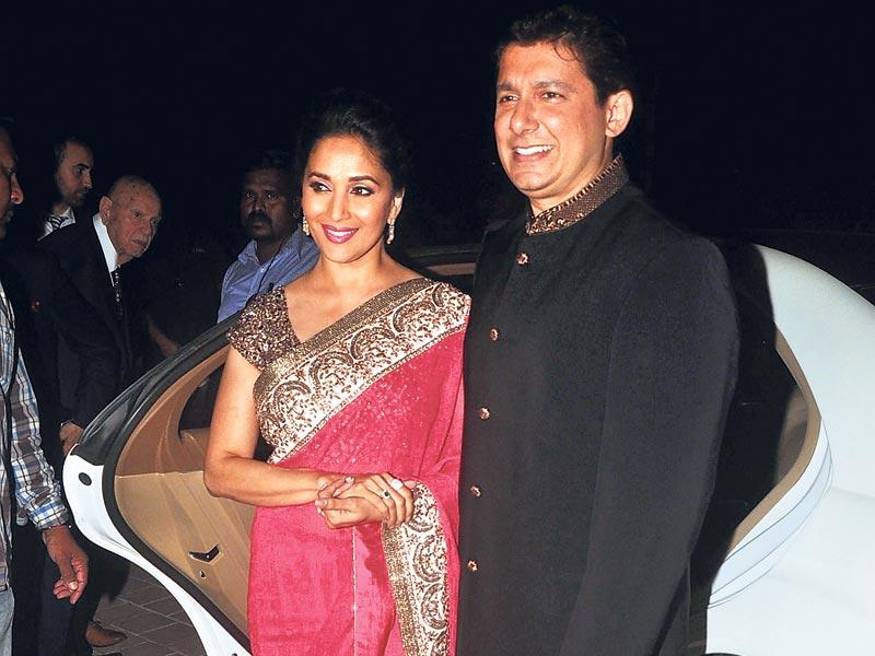 Madhuri Dixit with husband Shriram Nene at a pre-wedding function of businessman Sanjay Hinduja. (HT photo)