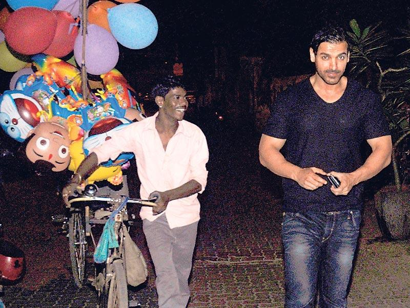 Late at night, a star-struck balloon seller was seen following John Abraham on a street in Mumbai. (HT photo)