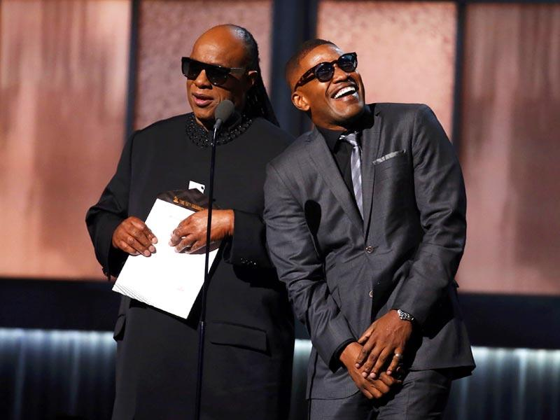 Jamie Foxx channeled his inner Ray Charles as he presented record of the year with Stevie Wonder. (Photo: Reuters)