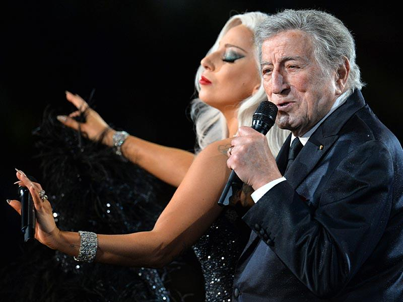 Lady Gaga gets cheeky with Tony Bennett as they waltz to their song Cheek to Cheek. (Photo: AFP)