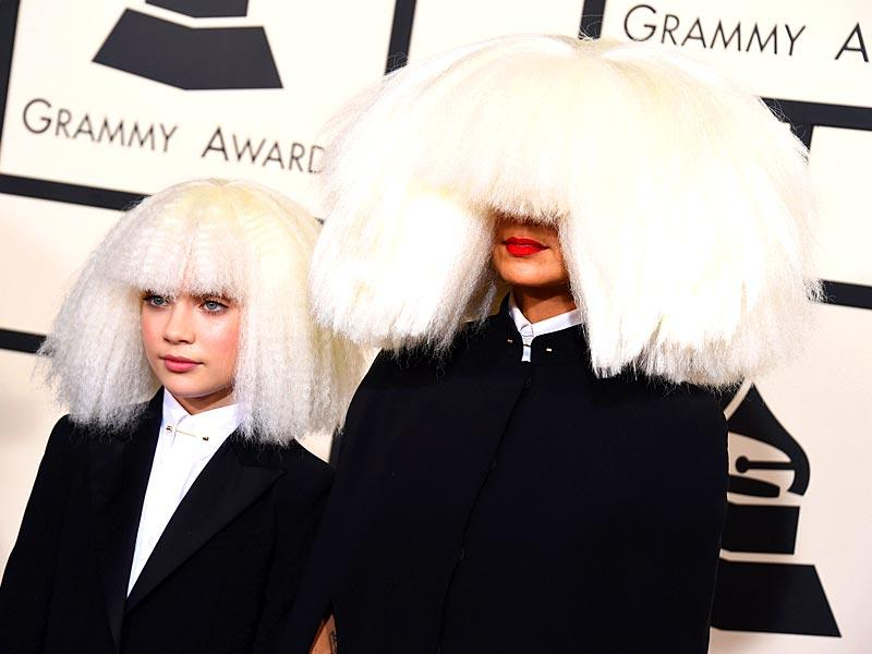 Notoriously 'face-shy' Sia arrives at the Grammys with Maddie Ziegler (who has featured in both Sia's Chandelier and Elastic Heart videos).(AP)