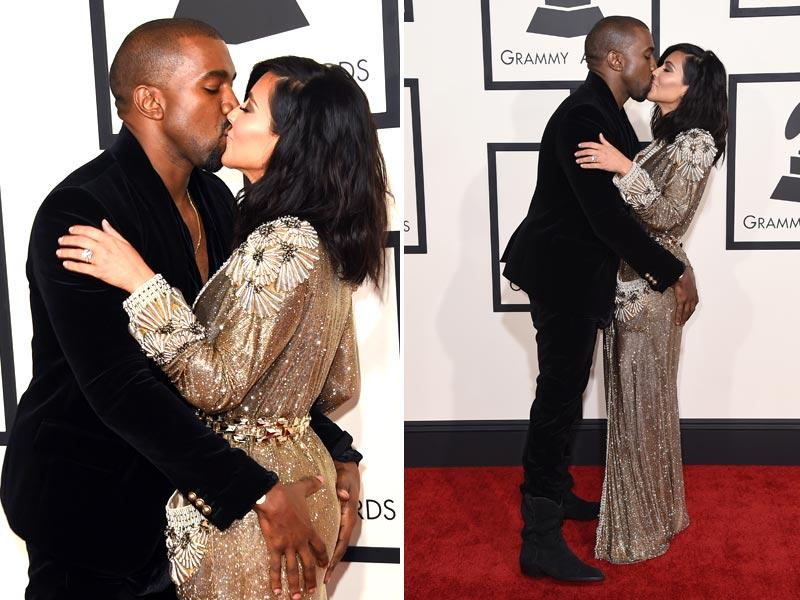Now, Kanye West just can't get enough of wife Kim Kardashian! Did the rapper 'forget' he's on the Grammy's red carpet, we don't think so! (AFP)
