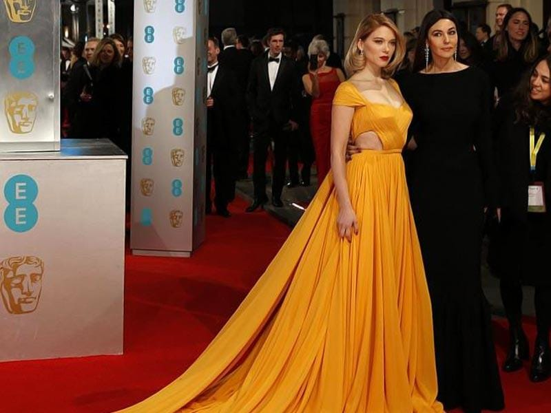 French actor Lea Seydoux (left) and Italian actor Monica Bellucci (right) look extravagent at the BAFTA red carpet. (AFP)