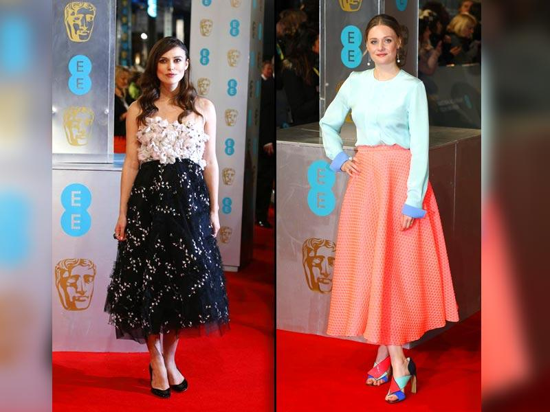 Keira Knightley (left) and Romola Garai (right) pose at the BAFTA red carpet, wearing gorgeous dresses. (AFP/Reuters)