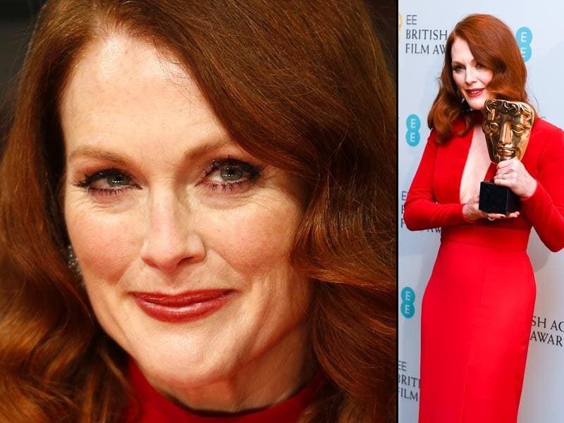 Still Alice actor Julianne Moore looks sexy in a red Tom Ford dress at BAFTA Awards. (AFP)