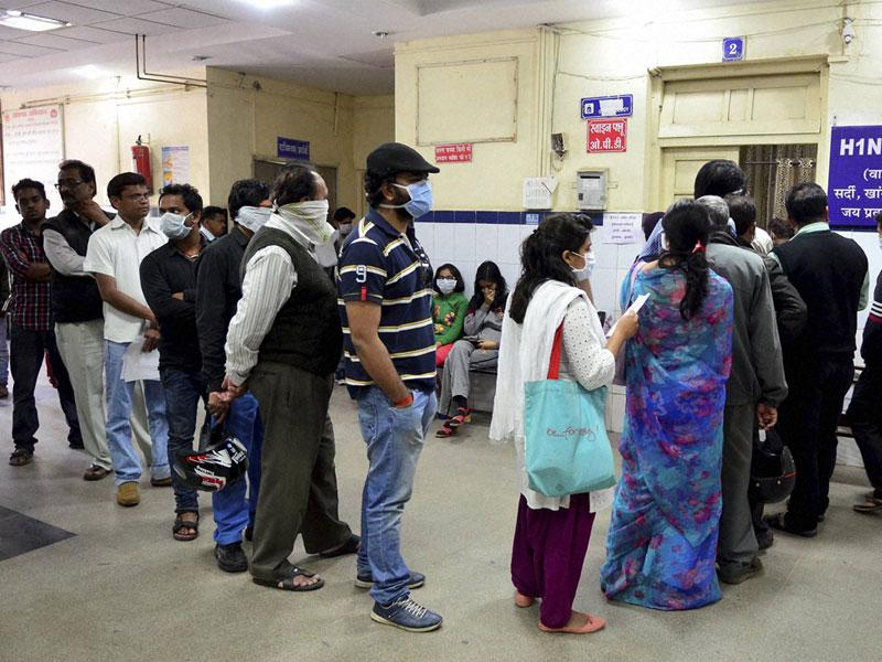 Suspected swine flu patients stand in queue at H1N1 diagnostic centre at Government Jai Prakash Hospital in Bhopal on Monday. (PTI photo)