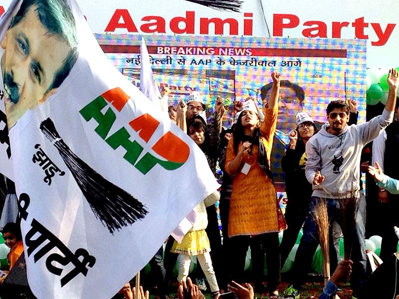 Supporters of AAP celebrate outside party's Patel Nagar office. (Arun Sharma/ HT Photo)
