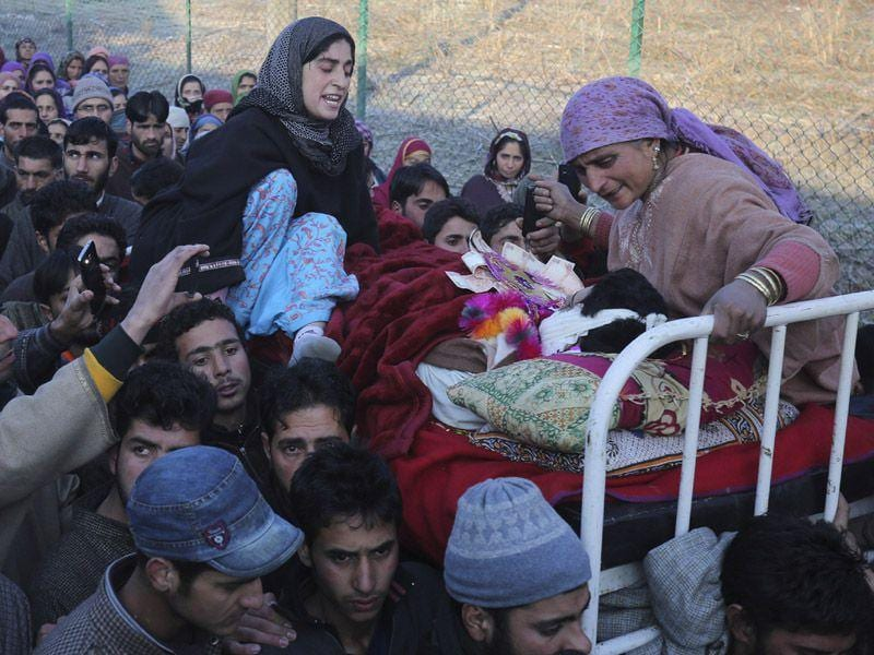 Mother and sister mourn as Kashmiri Muslims carry the body of civilian Farooq Ahmad Bhat during his funeral procession at Palhallan in Srinagar. Waseem Andrabi/HT