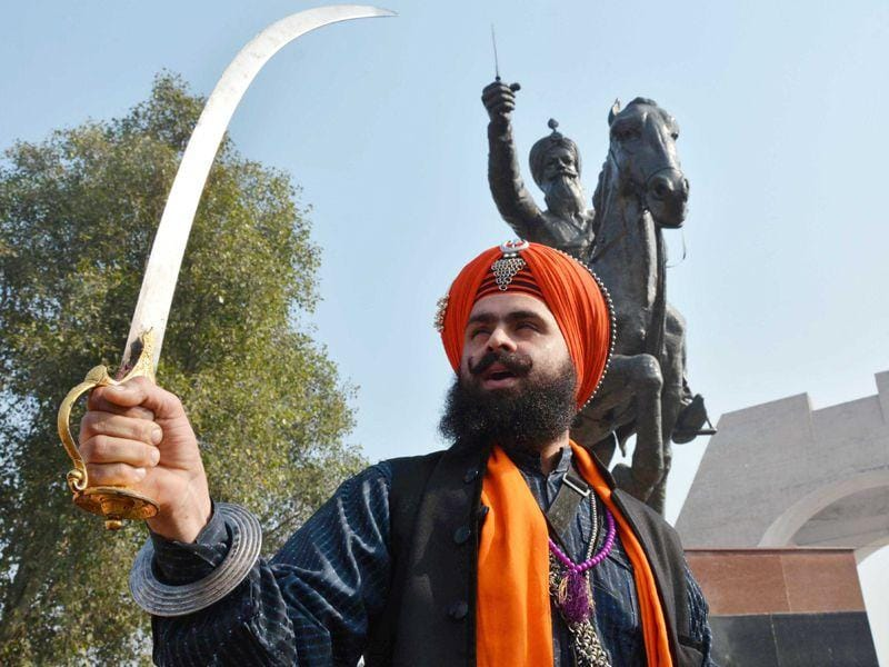 Nihang Dildar Singh holds a traditional sword and shouts slogans as he pay tribute to Sham Singh Attariwala on his martyrdom day in Amritsar on Tuesday. Sameer Sehgal/HT