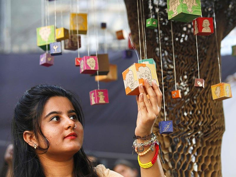 A young visitor takes a look at the art installation at the HT Kala Ghoda Arts Festival, in Mumbai. (Vidya Subramanian/HT photo)