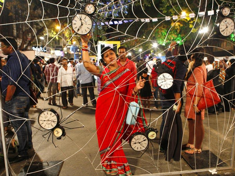 People pose next to an art installation at the HT Kala Ghoda Arts Festival, in Mumbai. (Vidya Subramanian/HT photo)