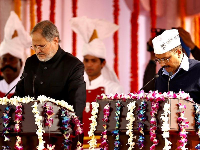 Aam Aadmi Party (AAP) convener Arvind Kejriwal takes the oath as Delhi chief minister during his swearing-in ceremony at Ramlila Maidan. (HT photo/Ajay Aggarwal)