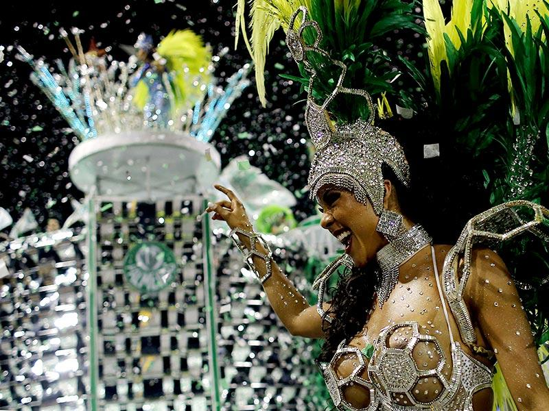 A reveller from the Mancha Verde Samba School takes part in a carnival at Anhembi Sambadrome in Sao Paulo on Valentine's Day. (Reuters)