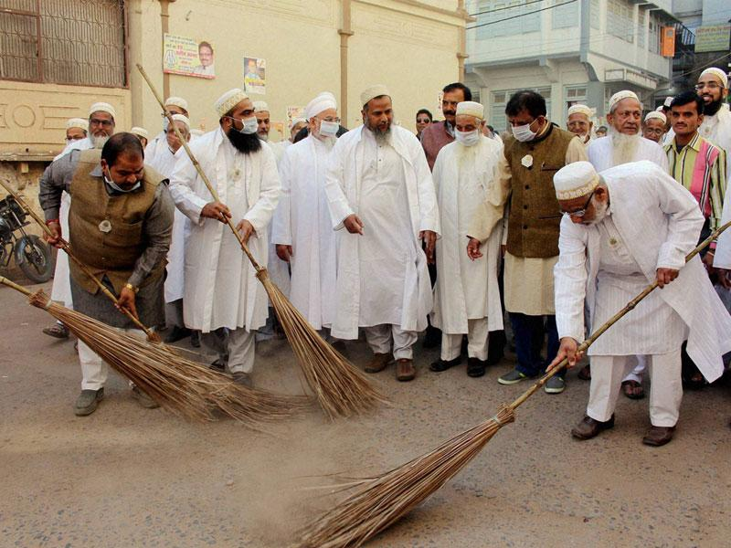Members of Dawoodi Bohra community take part in a cleanliness drive, in Bhopal on Saturday. (PTI photo)