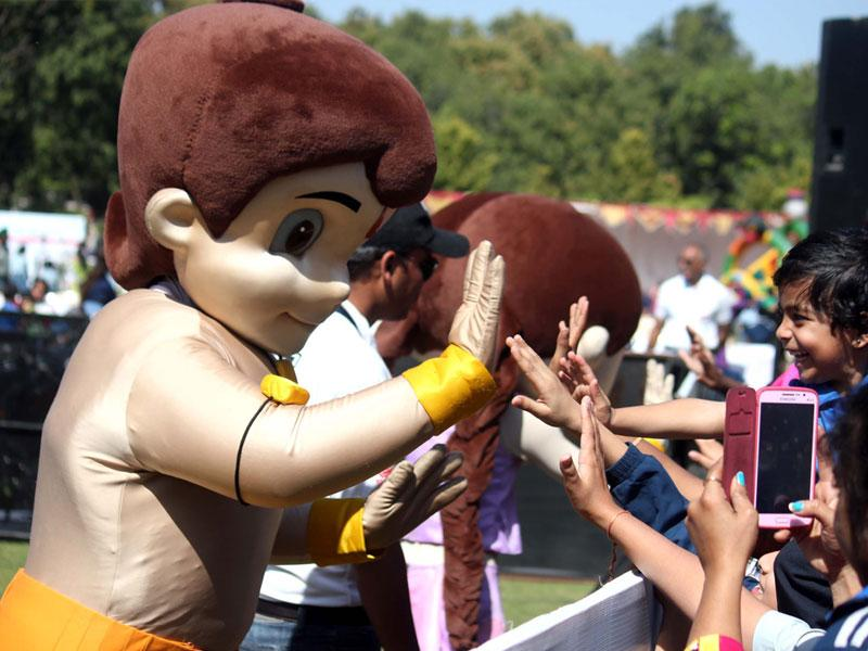 Chhota Bheem interacts with children during his visit to Emerald Heights International School in Indore on Saturday. (Shankar Mourya/HT photo)