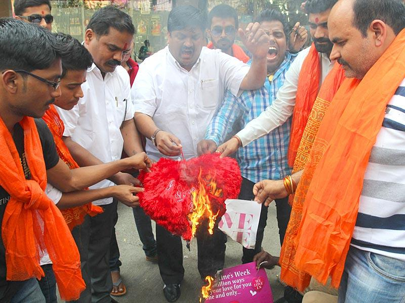 Vishwa Hindu Parishad activists protest against Valentine's Day and burn greeting cards in Thane. (Praful Gangurde/HT photo)