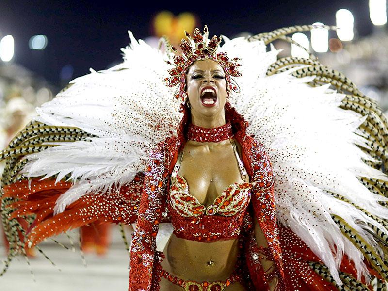 A reveller from the Alegria da Zona Sul samba school takes part in the Group A category of the annual Carnival parade in Rio de Janeiro's Sambadrome. (Reuters)