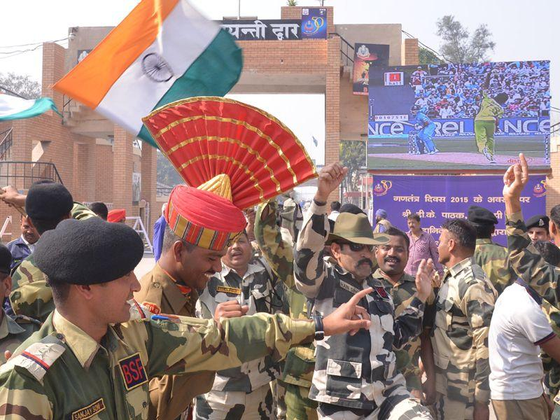 BSF personnel celebrate as they watch a live broadcast of the Cricket World Cup match between India and Pakistan at Border Post in Amritsar. Sameer Sehgal/HT