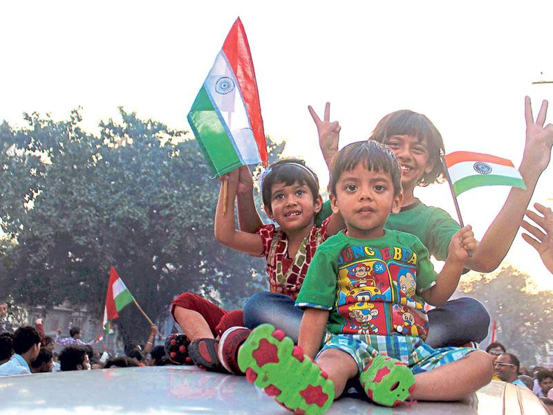 Children in Indore celebrate India's victory in the match between India and Pakistan on Sunday. (Shankar Mourya/HT photo)