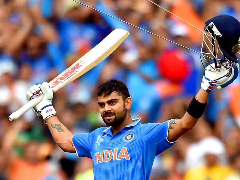 Indian batsman Virat Kohli celebrates as he reaches 100 runs against Pakistan during the Pool B 2015 Cricket World Cup match at the Adelaide Oval. (AFP photo/Saeed Khan)